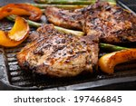 juicy pork chops are grilled on ... | Shutterstock . vector #197466845