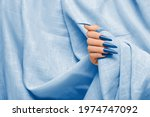 Female Hand With Blue Stiletto...