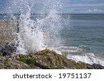 Waves Crashing Against A Rock...