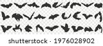 flying bat with wings doodle...   Shutterstock .eps vector #1976028902