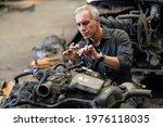 Senior Engineer Checking Old...
