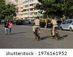 Small photo of Mumbai, Maharashtra, INDIA – Dec 14 2017: Two Police officers riding bikes together on marine drive in Mumbai city. As a part of their routine roundups .this photo shows modernity and adaptability.