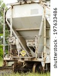 Small photo of Railcar of Ammonium nitrate sits at a siding near a rock blasting operation