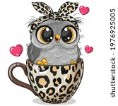 cute cartoon owl with a bow is... | Shutterstock .eps vector #1976925005