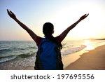 cheering woman hiker open arms... | Shutterstock . vector #197695556
