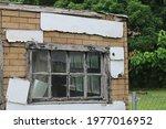 A Old Black Window In A Tar...
