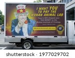 Small photo of Washington, DC – May 18, 2021: A truck feature a likeness of Dr. Anthony Fauci as Uncle Sam and questioning his supposed expenditures through the NIH on dangerous animal virus experiments in China.