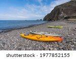 Stoney beach cove with kayaks near Scorpion Ranch on Santa Cruz Island in Channel Islands National Park near Los Angeles and Ventura, California, USA.