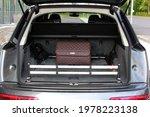Small photo of Vinnytsia, Ukraine; May 22, 2021. Audi Q7 S-line open trunk. Audi Q7 trunk with audi service bag. Audi service bag. Editorial photo.