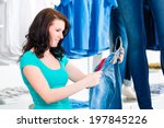 woman buying fashion blue jeans ... | Shutterstock . vector #197845226