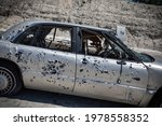 Junk Cars With Bullet Holes And ...