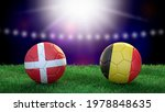 Two soccer balls in flags colors on stadium blurred background. Denmark and Belgium. 3d image