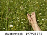 feet of a young woman lying in... | Shutterstock . vector #197935976