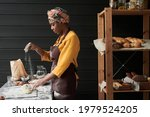 African Baker In Apron Making A ...