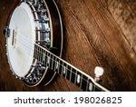 five string banjo on a hardwood ...