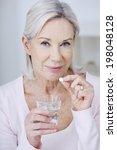 senior woman taking medicine. | Shutterstock . vector #198048128