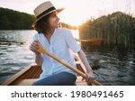 Smiling Woman Enjoying A Canoe...