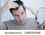 man with mirror | Shutterstock . vector #198054098