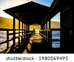 Silhouette Of A Man Fishing At...