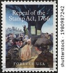Small photo of Milan, Italy - May 08, 2021: Repeal of the stamp act on american postage stamp