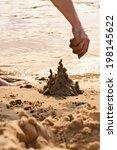 Hand Building The Sand Castle