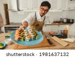 asian chef hold plate with set...   Shutterstock . vector #1981637132