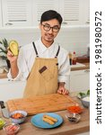 portrait of asian smiling chef...   Shutterstock . vector #1981980572