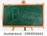 A Chalkboard With The Word...