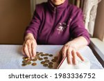 Concerned Elderly Woman Sitting ...