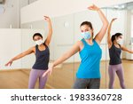 Ladies In Fase Masks Dancing...