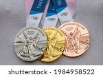 Small photo of April 17, 2021 Tokyo, Japan. Gold, silver and bronze medals of the XXXII Summer Olympic Games in Tokyo on the chest of the athlete.