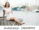 Happy Pregnancy Woman Sitting...