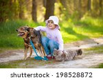 Stock photo little girl with big dog and cat in the forest 198528872