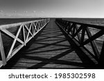 Small photo of A gangplank on a big lake.