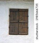an old window shuttered on a... | Shutterstock . vector #1985666735