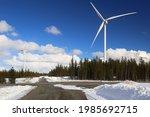snowy road in amliden wind park ... | Shutterstock . vector #1985692715