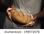 Baker Man Holding A Warm Bread