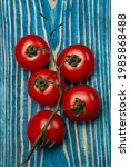 bunch of tomatoes on blue...   Shutterstock . vector #1985868488