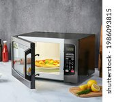 Opened Microwave On Kitchen...
