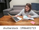 young woman working from home....   Shutterstock . vector #1986601715