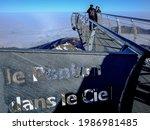 """Small photo of LA MONGIE, FRANCE - Jan 02, 2019: Tourist attraction """"Le Ponton dans le Ciel"""" at the Pic du Midi de Bigorre, Pyrenees, France"""