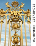 Small photo of Gate adorned with fleur-de-lys, a royal symbol, overlooking the court of honor of the Versailles palace (August 2, 2017)