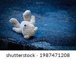 Teddy Bear Lying Down Outdoors...