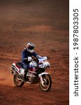 Small photo of Rider on a off-road motorbike on the desert rally. Rally raid THE GOLD OF KAGAN-2021. 24.04.2021 Astrakhan, Russia.