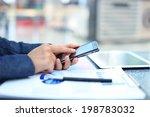 Businessman Using Digital...