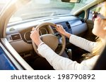 Woman  Holding A Steering...