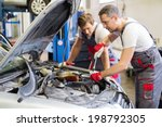 two mechanic fixing car in a... | Shutterstock . vector #198792305