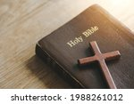 A Cross With The Holy Bible Is...