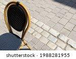 Bistro Chair On The Sidewalk...