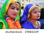 AUCKLAND - OCT 16, 2006. Two unidentified performers rest in between sets at the annual Diwali Festival at Auckland's Britomart Centre on Oct 16, 2006 in Auckland, NZ. Hindus celebrate the event globally. - stock photo